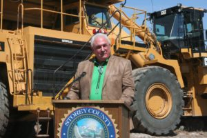 Tahoe Reno Industrial Center developer Lance Gilman speaks during the groundbreaking ceremony for the USA Parkway extension project.