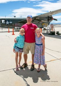 Photos by Joseph Maino The Nerska family, Alex, Chris and Josie, stand in front of the B-25 Mitchell bomber, the same type of plane worked on by the girls' great grandfather during World War II.