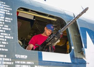 Chris Nerska tries out the B-17's machine gun.