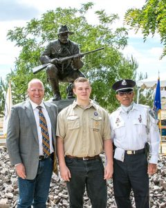 Artist Scott Rogers, Boy Scout Noah Foist and Brett Palmer (Nevada Veteran's Coalition) pose in front of The Trooper.