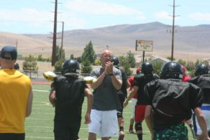 Photos by Robert Perea, The Fernley Reporter Eastern Oregon football coach Tim Camp shouts encouragement to players during drills last Thursday at the camp hosted by Eastern Oregon coaches at Fernley High School.
