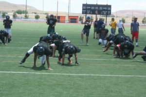 Fernley players participate in drills during the Eastern Oregon University football camp at Fernley High School.