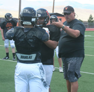 Fernley coach Chris Ward instructs players during the Eastern Oregon University football camp