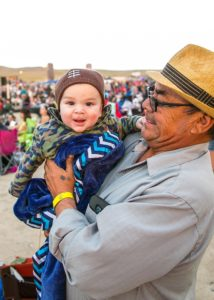 Grandfather, Porfirio Reyes and his 5 month old grandson, Santino Josiah from Sanger, Calif. enjoy the great weather.