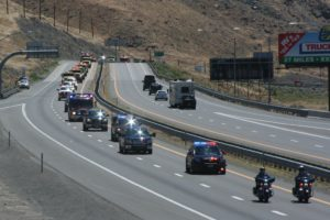 Robert Perea, The Fernley Reporter The procession escorting the fallen BLM firefighters pulls into Sparks.