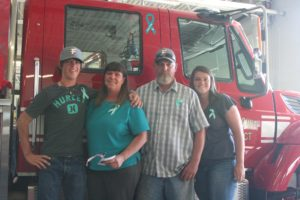 Robert Perea, The Fernley Reporter The family of Jayme King, from left her brother Jay, mother Staci, father James and sister Jordan, stand next to the new fire truck dedicated to her memory by the North Lyon County Fire Protection District.