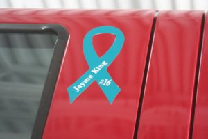 A ribbon on the new fire engine signifies its dedication to Jayme King,