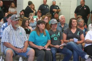 The King family listens as fire chief Scott Huntley speaks during the dedication ceremony,