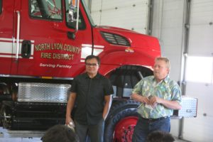 Reverand John Poundstone and Father Joseph Infante speak at the dedication of the North Lyon County Fire Protection District's new Type 3 fire engine,