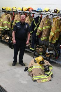 Robert Perea, The Fernley Reporter Steve Emery shows his firefighter's gear.