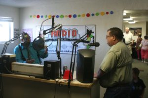 Robert Perea, The Fernley Reporter JFierce Rodriguez talks on the air with Fernley Mayor Roy Edgington during the Open House for Biggest Little Radio.