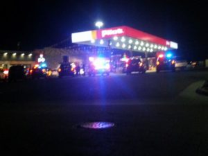 Photo provided by Jared Tyner Police and emergency vehicles surround the parking lot at the Pilot Travel Center after a car chase ended with a deputy-involved shooting early Wednesday morning.