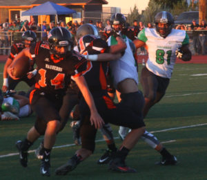 Robert Perea, The Fernley Reporter Fernley's Zach Burns runs with the ball during the first half of Fernley's game against Fallon Friday night.