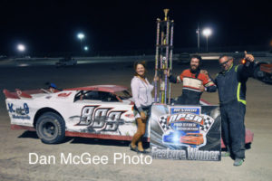 Photo provided by Dan McGee James Gonzalez celebrates with Gordon Russell his victory and beside the money he gets the six foot tall trophy.