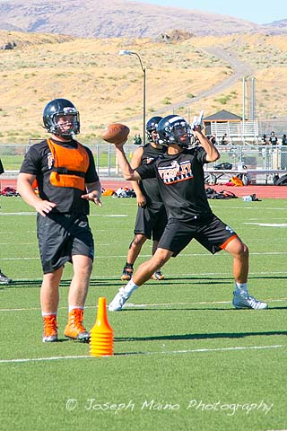 Quarterback Ren Arroyo throws a pass during practice on Tuesday, Aug. 9. Arroyo is battling with junior Zach Burns for the starting quarterback position.
