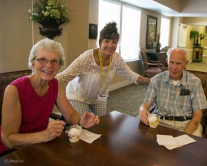 Mary Wells, center, makes sure Paul and Sara Webster get their fair share of ice cream.