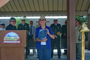 Constance Anton-Knoll shows per plaque after being named the Fernley Patriot of the Year.