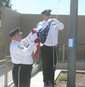 Nevada Veterans Coalition Honor Guard members Tommy Summers, right, and Sam Fisher prepare to hoist the flag.