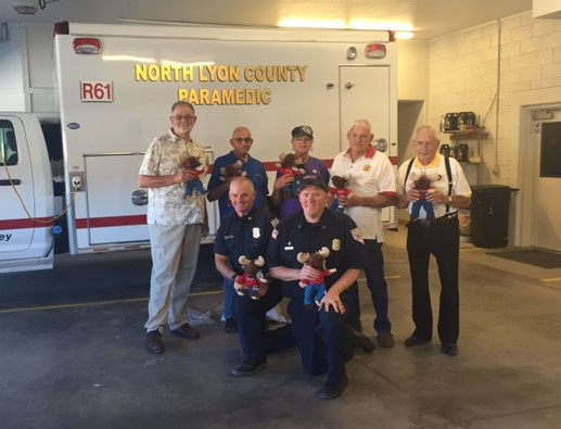 The Loyal Order of Moose Fernley Lodge #2468 donated 48 Tommy Moose dolls to the North Lyon County Fire Protection District. Pictured are Bill Hargis, Orly Greco, Janae Durrant, Larry Hatfield, and Mac McClury of the Moose Lodge with Fire Chief Scott Huntley and firefighter/EMT J.T. McCoy.