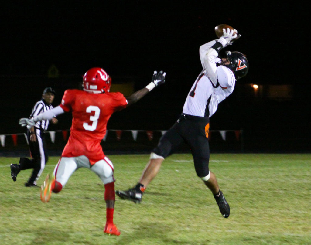 Ren Arroyo catches a pass in front of Wooster's Phaezon Wright on the game-winning drive,