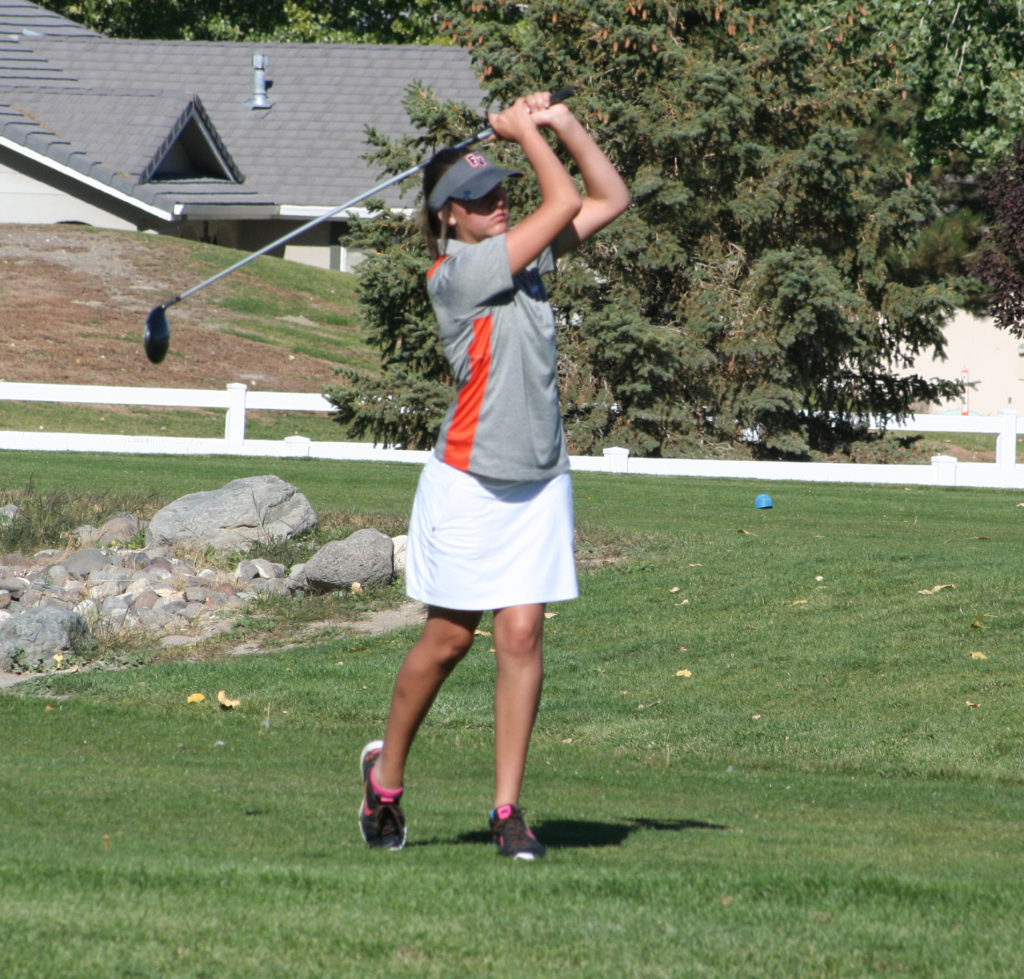 Robert Perea, The Fernley Reporter Megan Thompson watches her drive on the first hole of Tuesday's meet in Fernley.