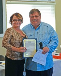 Mayor Roy Edgington presents the Saturday Nov 26th Small Business Saturday proclamation to Tracy Jo Johnson, President of the Fernley Chamber of Commerce.